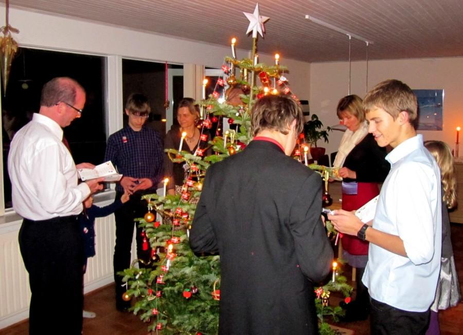 Danish family standing around the Christmas tree.