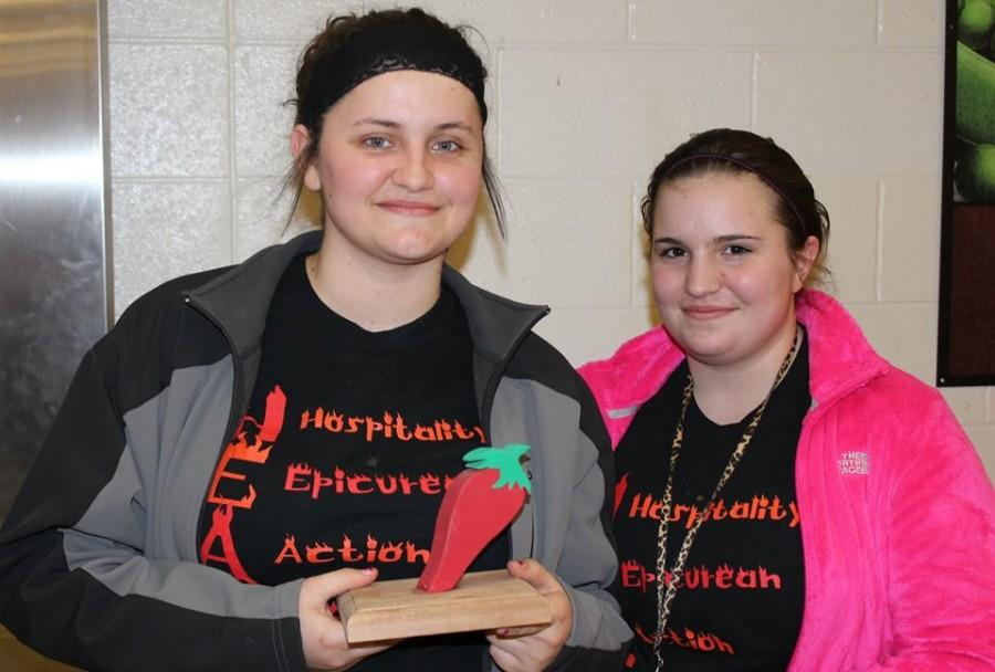 Winners of the chili cook-off, Brittany Baldes and Bryanna Rahn proudly present their trophy.
