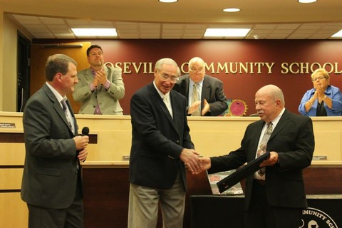 Retired auto teacher Paul Tregembo Sr. received recognition from superintendent John Kment.