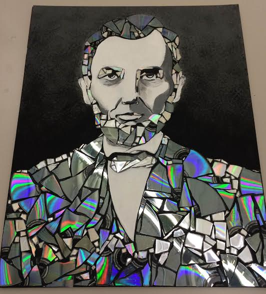 Stanley's mixed media of Abraham Lincoln made out of broken CDs.