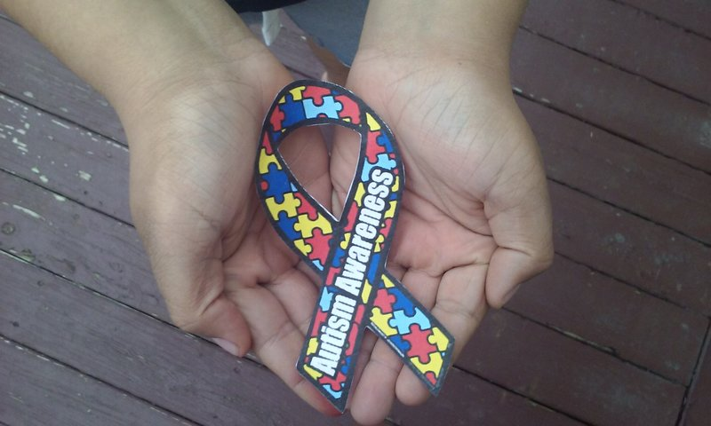 You can support by spreading awareness by advertising the autism awareness ribbon.