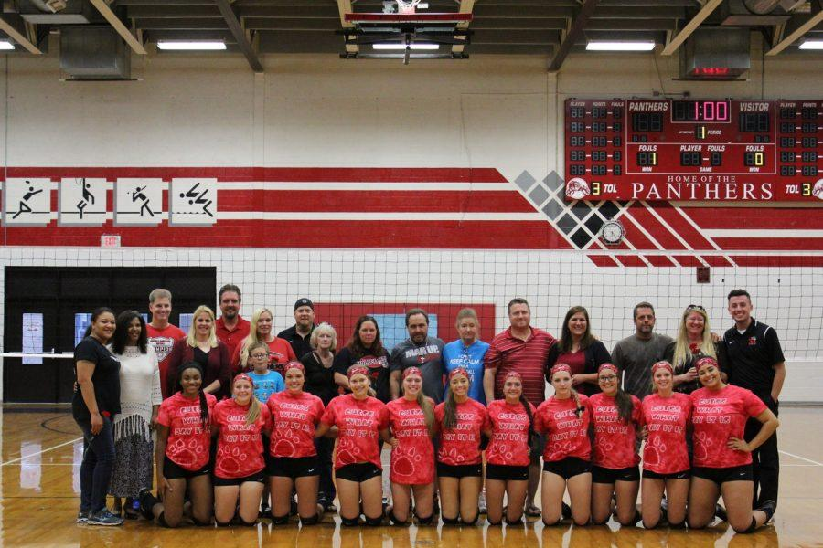 Varsity Volleyball gives each of their parents a rose to show appreciation.