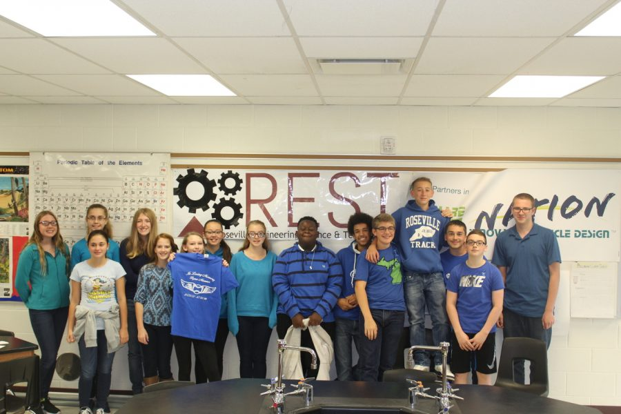 Fellow classmates of Ryan Mannes wear blue attire to honor his life.