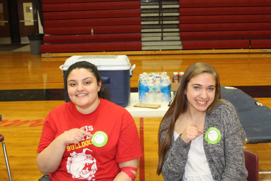 Seniors+Safa+Shkoukani+and+Brittany+Major+pose+with+their+%22Make+a+Difference%22+stickers+after+they+donated+blood.