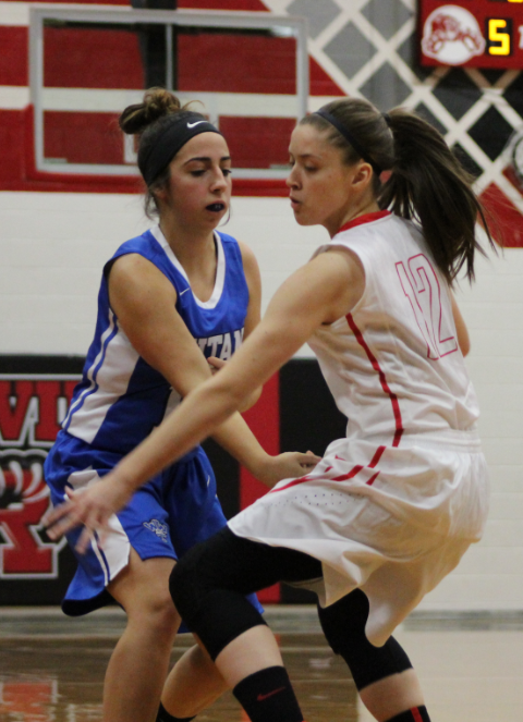 Junior Madelyn Lagassa guards Warren Woods Tower girl from trying to get the ball.