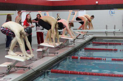 Swim team lands a tie