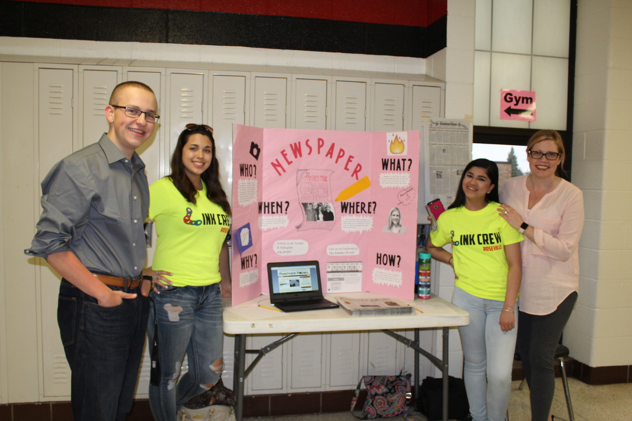 The new link leader members standing with the newspaper staff for the eighth grade welcome night.