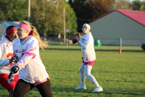 Juniors and Seniors battle neck in neck to win  the Powder Puff game.`