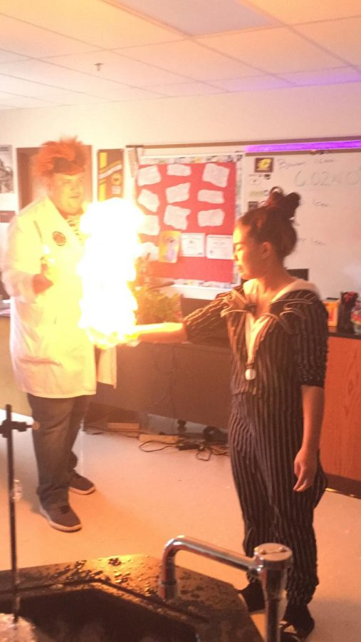 Science+teacher%2C+Smitka%2C+letting+a+student+make+fire.+