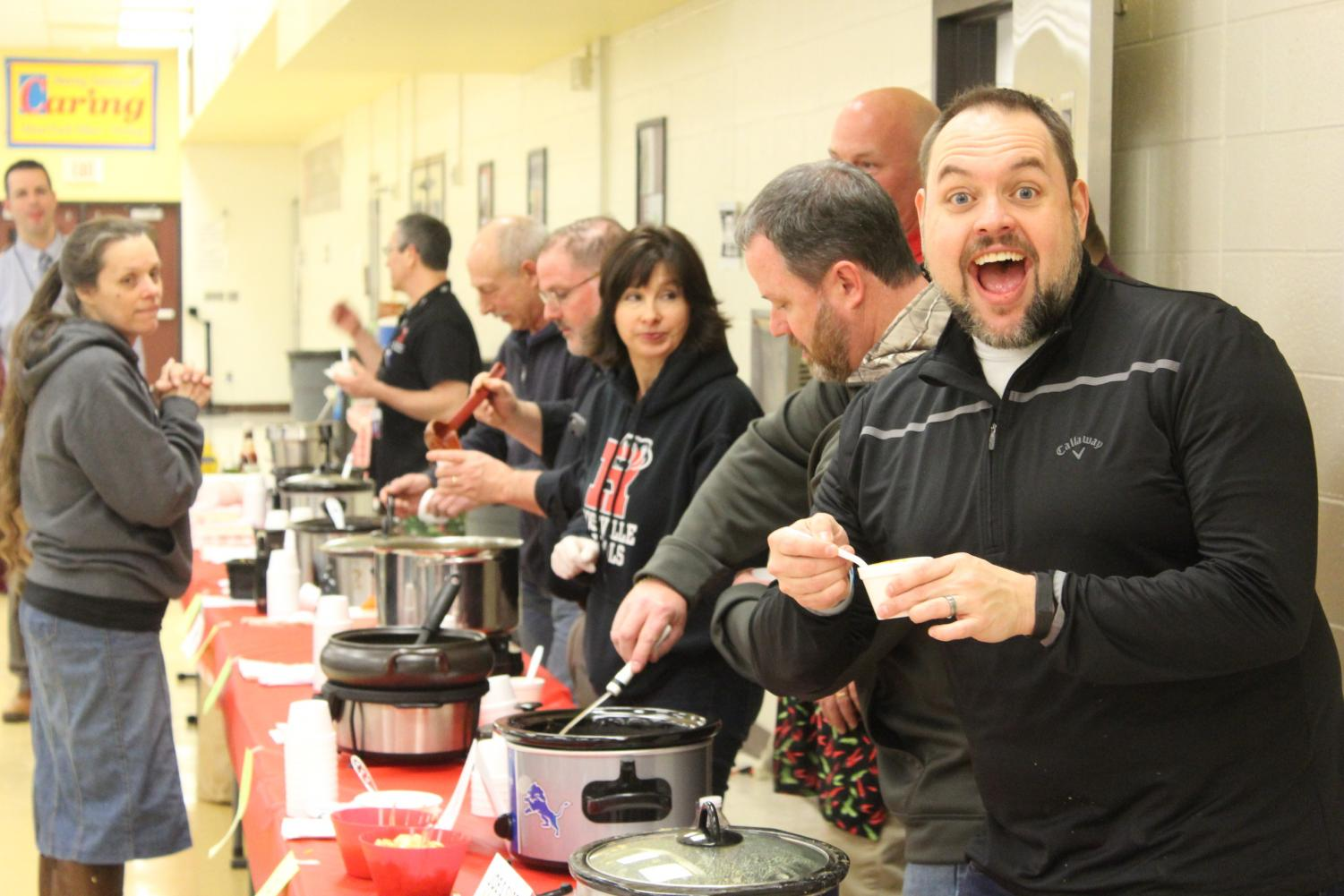 Participants cook and serve their chilis.