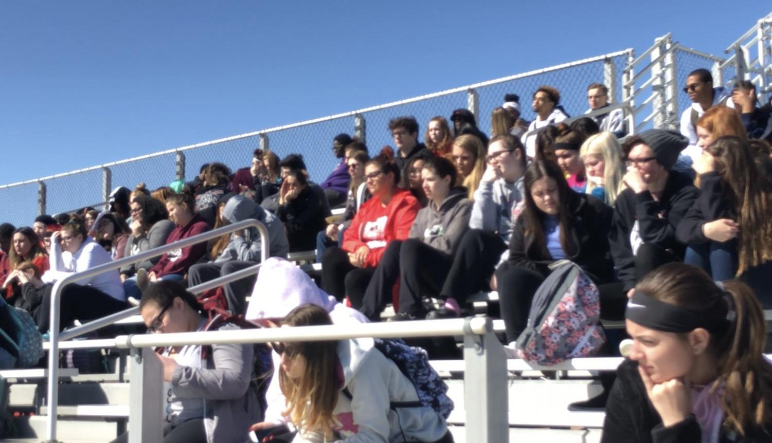 Students gather on the bleachers for the walkout.