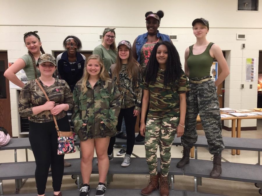 Symphonic+choir+students+participate+all+dressed+up+in+their+camouflage+gear.+
