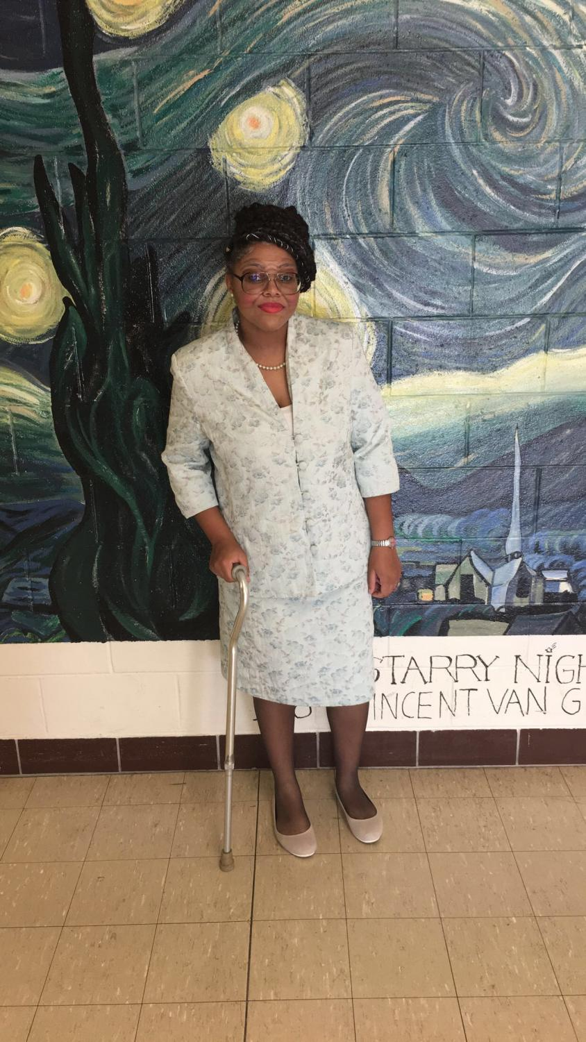 Senior Anitra Vance does her best impression of an elderly lady.