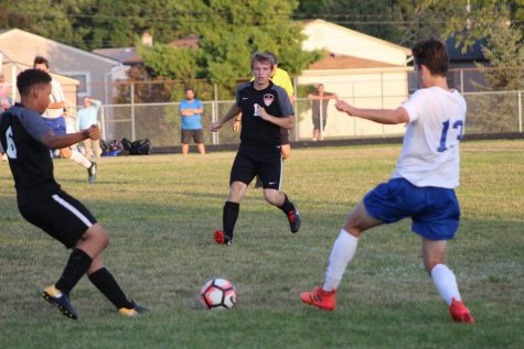 Varsity soccer team play a vigorous game