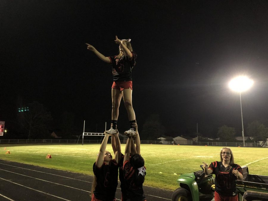 Cheerleaders show off their skill during the game.