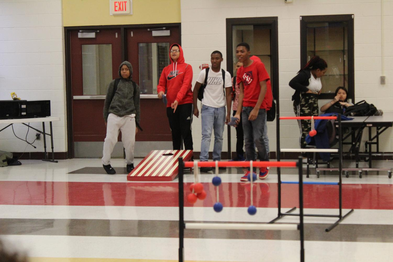 Freshmen join in on a game of bean bag toss.