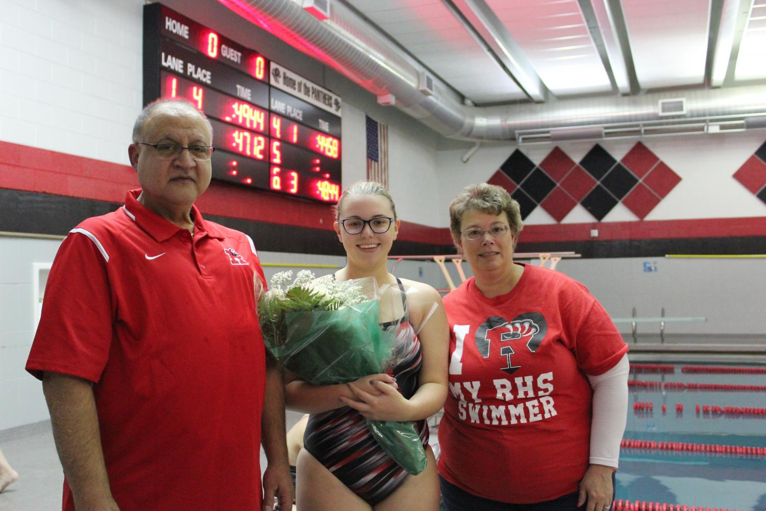 Senior Caitlin Michael and her parents on Senior Night