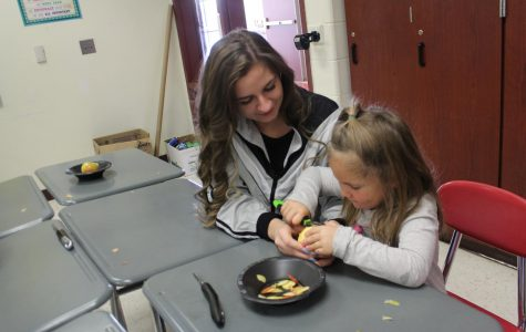 Childcare students spend time with kindergarteners