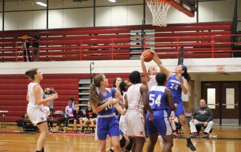 Girls varsity basketball defeats Lamphere while celebrating parent night