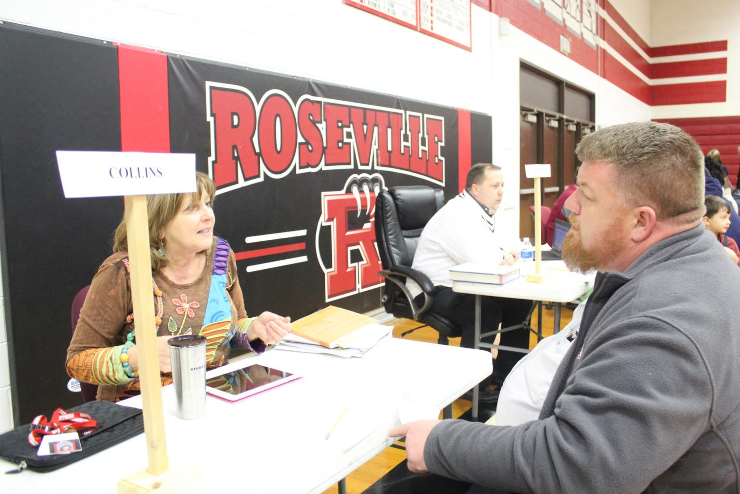 Music teacher Kristina Collins talks to a parent.