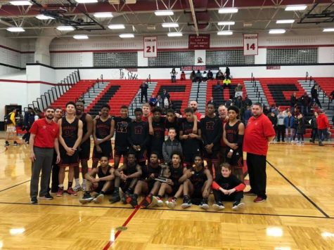 Boys basketball team defeats Fraser to become district champions