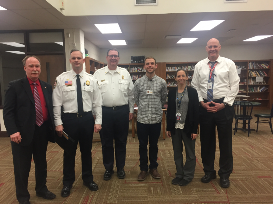 Mayor Robert Taylor, Chief of Police Ryan Monroe, Fire Chief Michael Holland Couselor Jenifer Korzeniowski and Care organization member Ryan Rublin pose for a photo after the meeting.