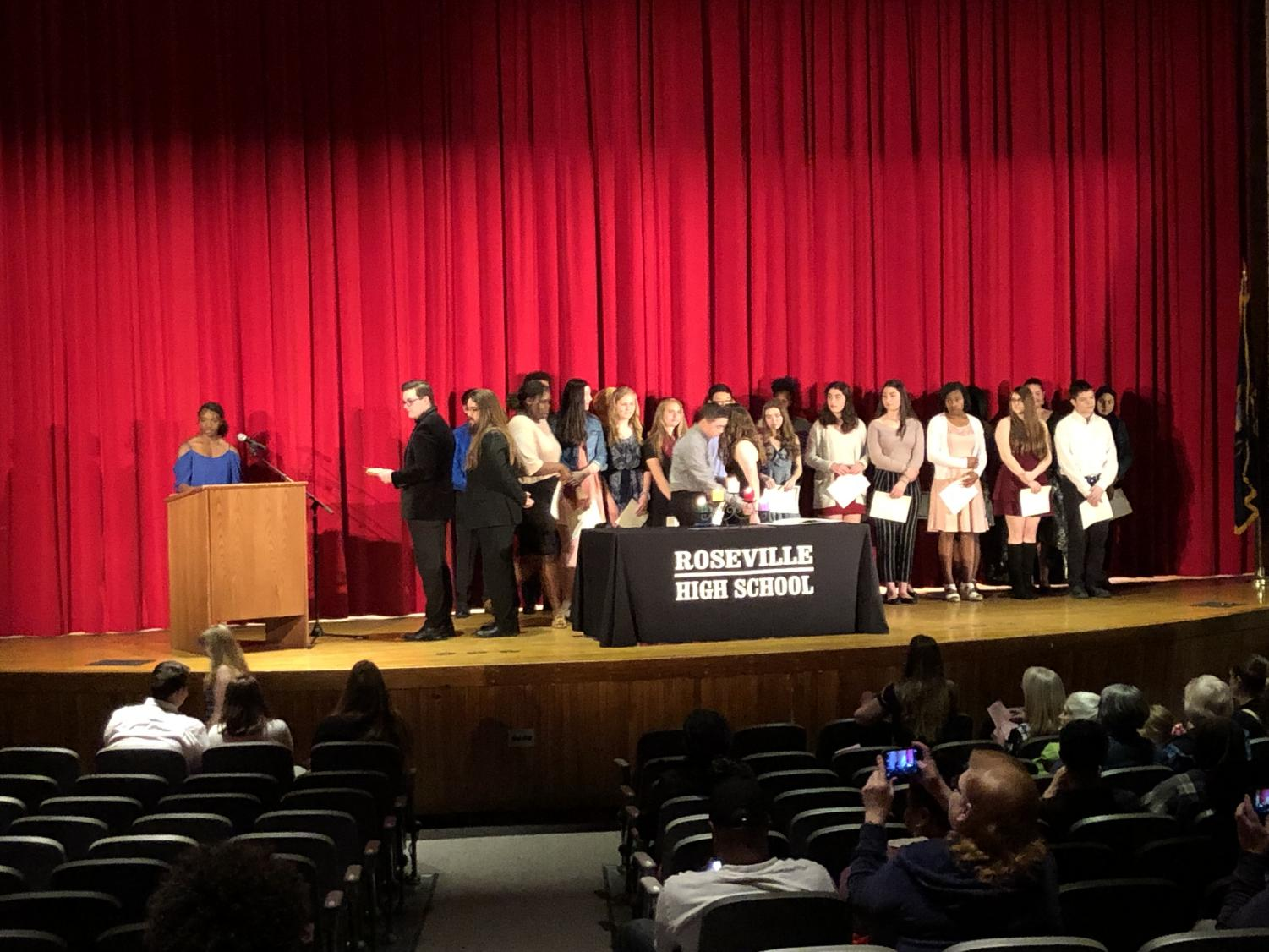 The 35 new members of NHS are now inducted.