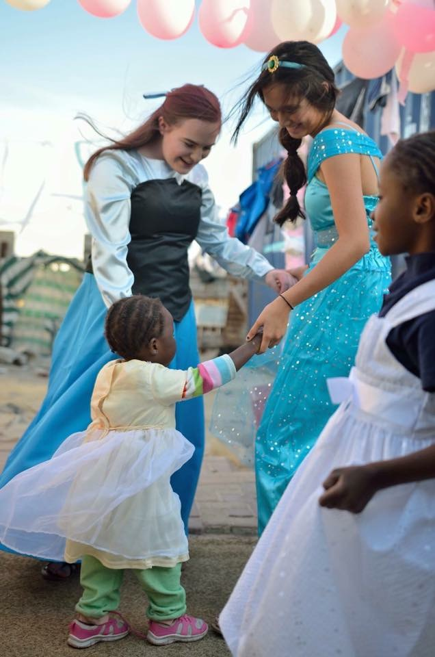 Mission group volenteers dressed up at princesses to host a party for the girls in the community.