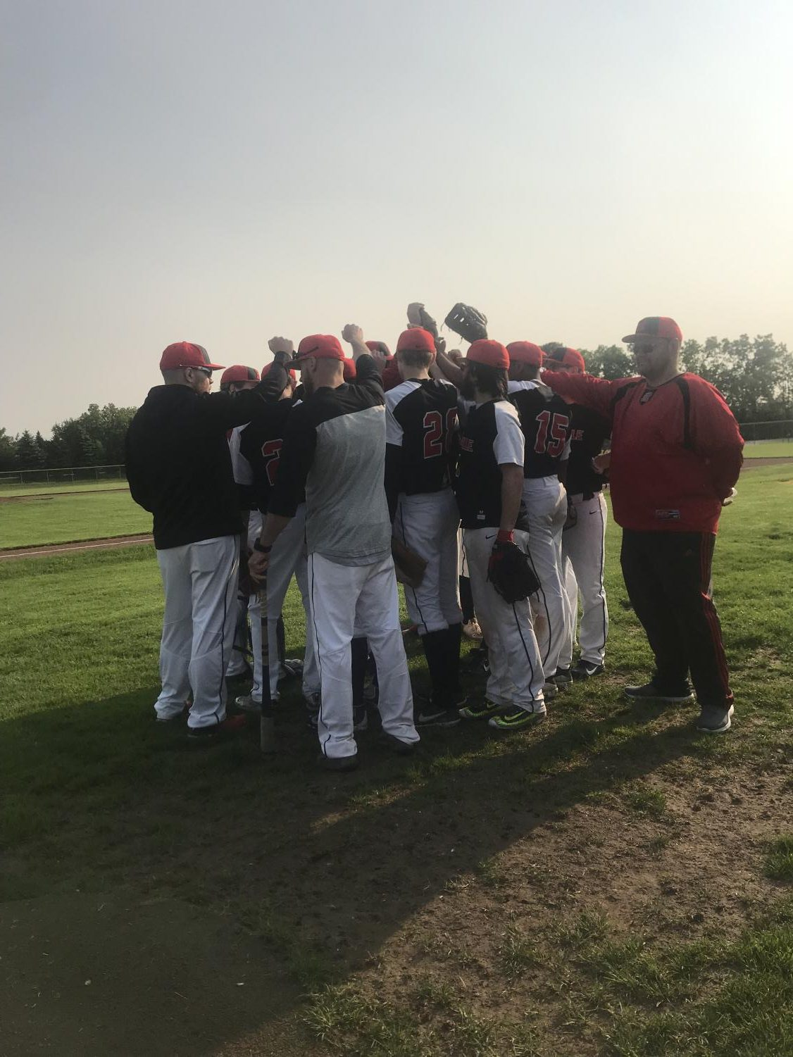 The panthers getting words of encouragement from Coach Keith Marzec as they get ready to play game one of the 2019 districts.