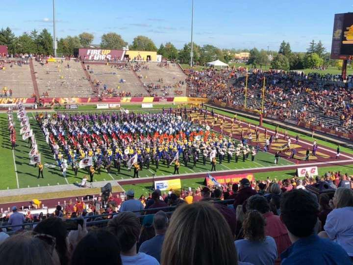 The marching Panthers perform along other schools during CMU's halftime.