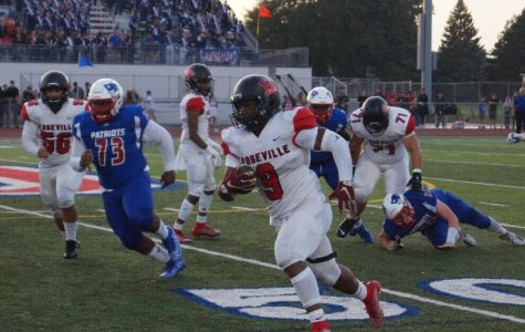 Senior Daivon Lowman outruns the Cousino defense as he crosses the 50 yard line.
