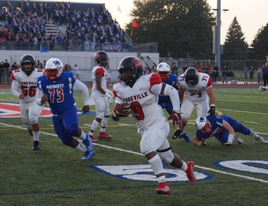 Senior+Daivon+Lowman+outruns+the+Cousino+defense+as+he+crosses+the+50+yard+line.
