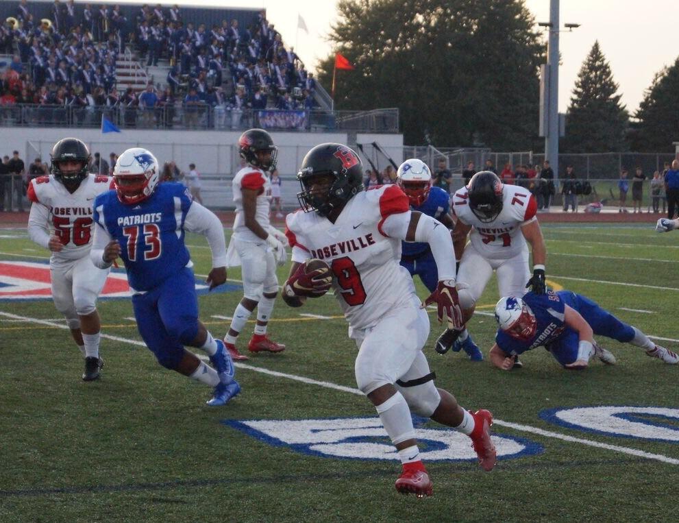 Senior Daivon Lowman outruns the Cousino defense as he crosses the 50 yard line.