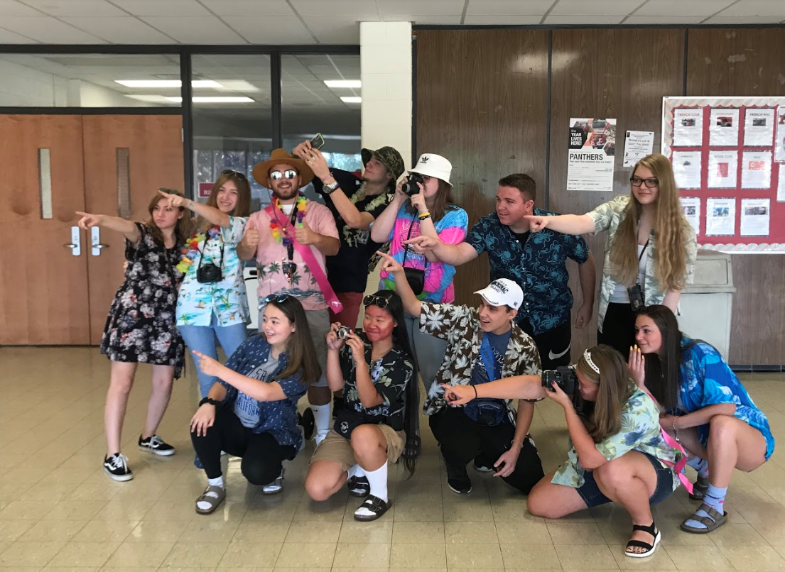Seniors participating in tacky tourist Tuesday by posing with their tour group.