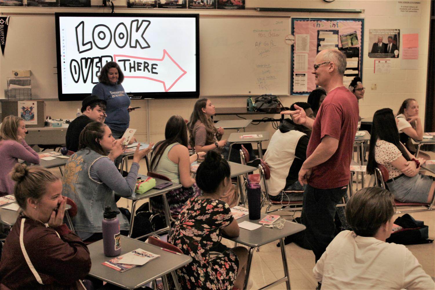 Cartoonist James Strum discusses importance of democracy with students.