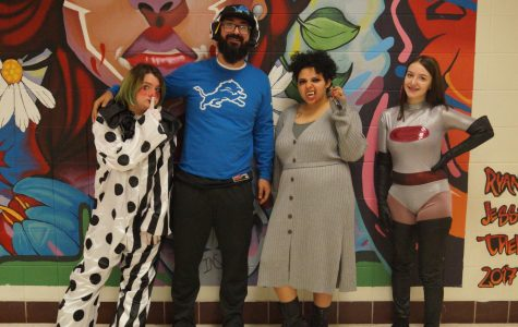 Teacher Jeff Awwad and students dress up in various costumes for Halloween.