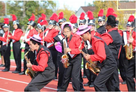 Saxophone section performed with fun hats to fire up the students.