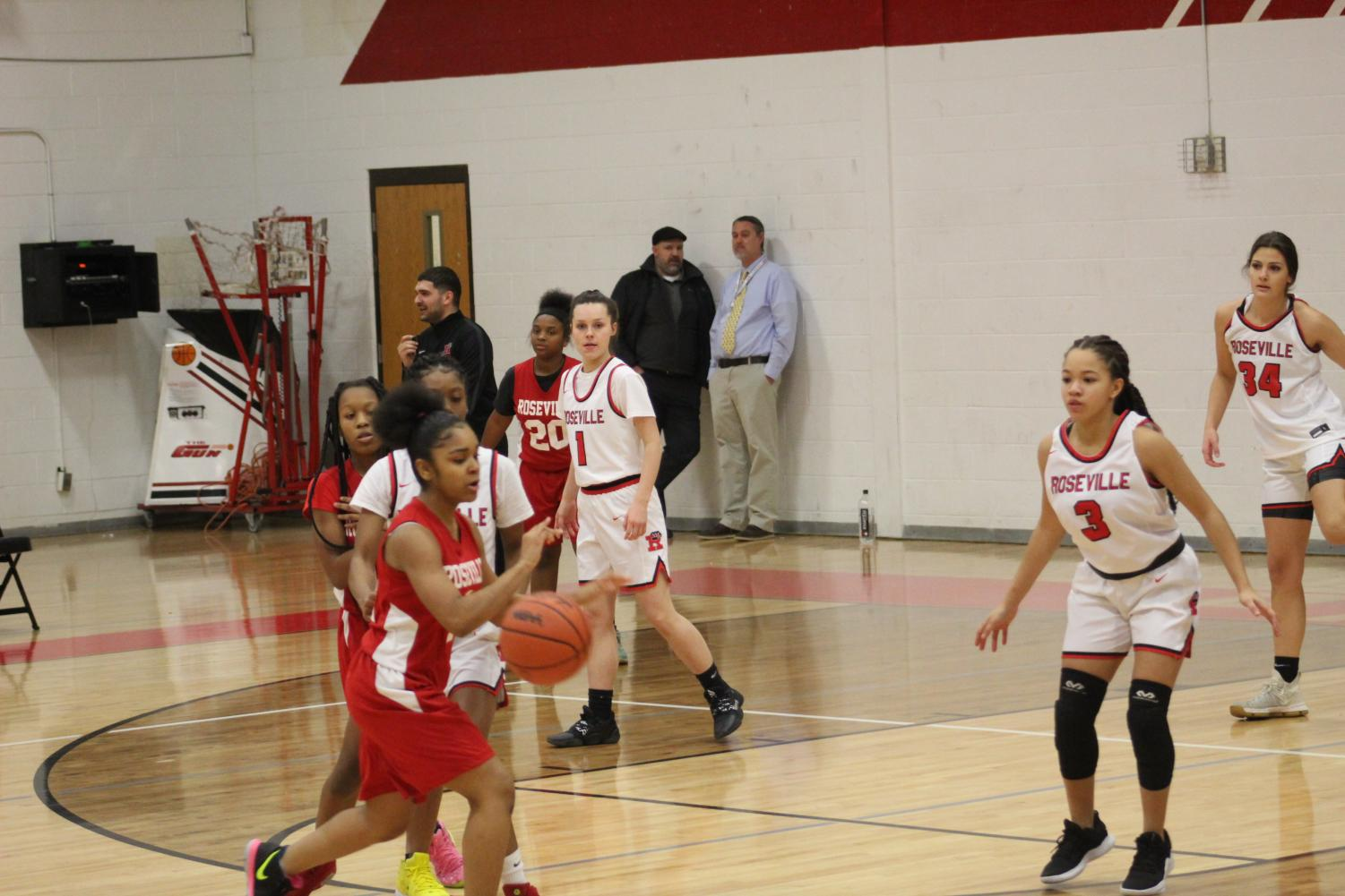 Saniah Love dribbling the ball to get ready to make a shot.
