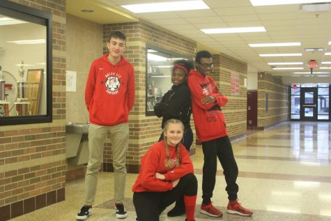 Juniors Lucas Horsley, Janai Carter, Camillia Matyszewski and senior Caleb Douglas show their spirit by wearing red.