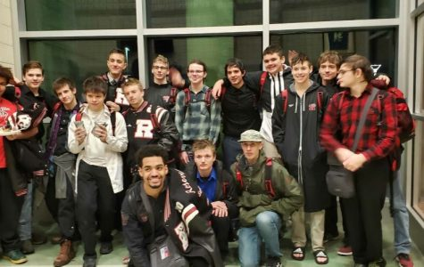 The boy's varsity swim team celebrating their win with snacks after the meet.