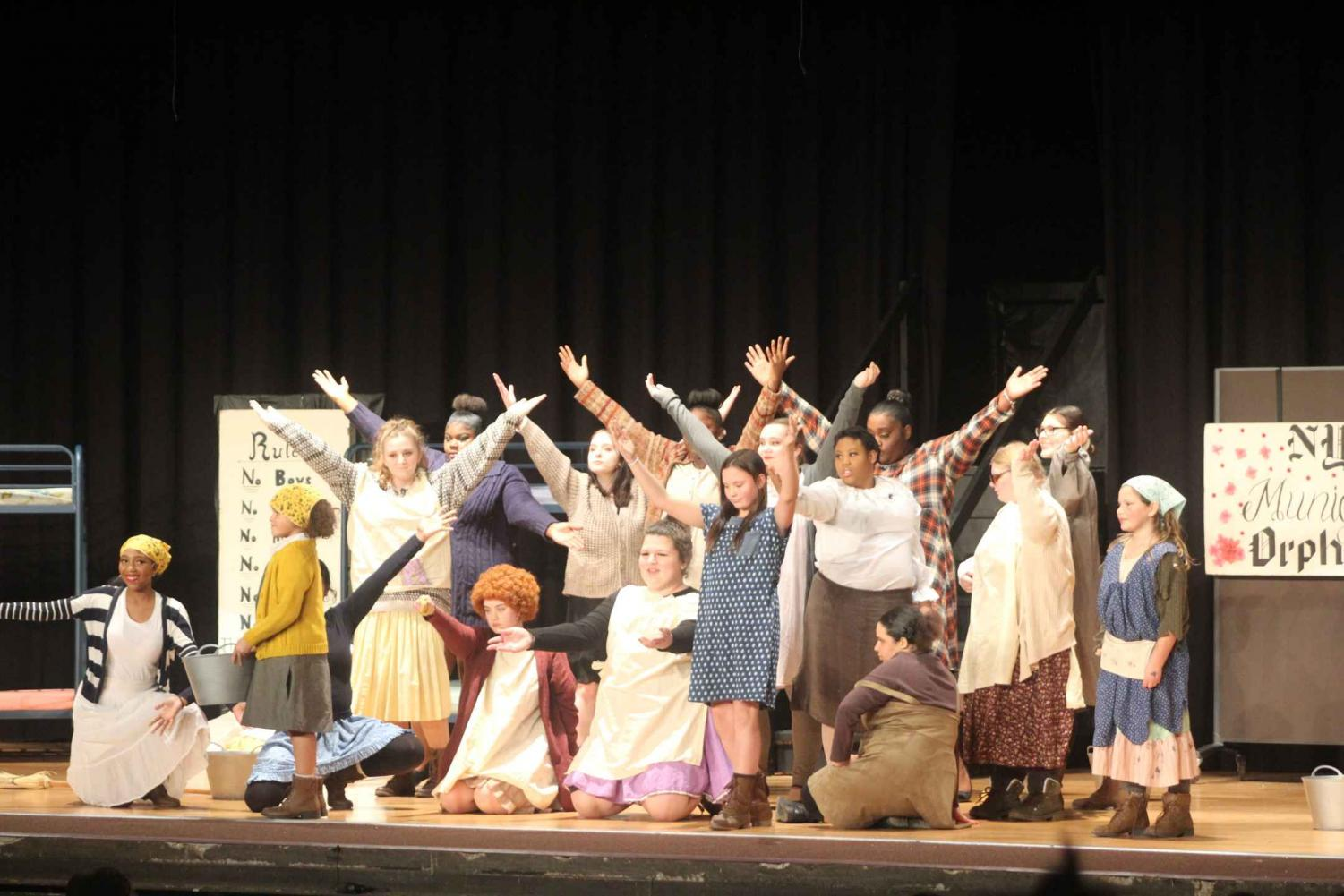 Drama Society members and kids posing as they finish one of the songs of the night.