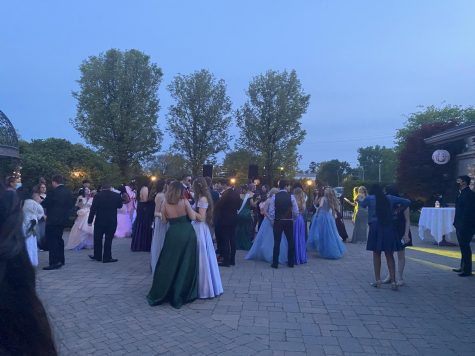 Seniors gather as the dance was held in the outside area of the Vintage House.